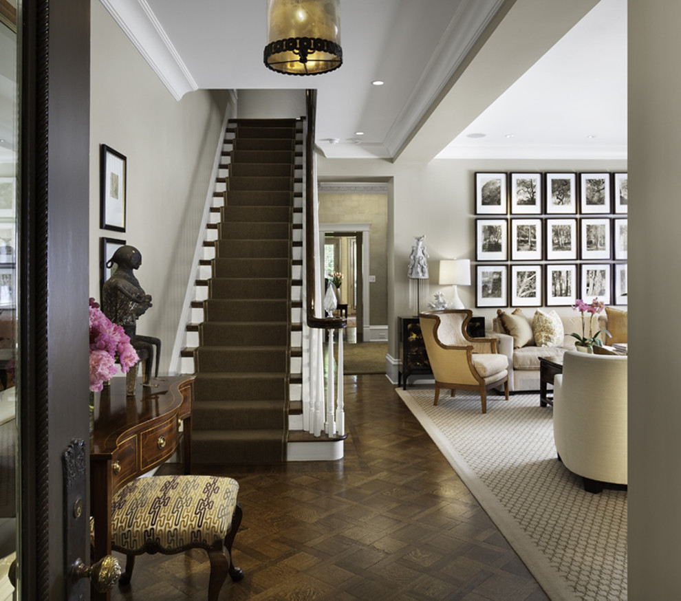 Example of a classic dark wood floor entryway design in Chicago with gray walls
