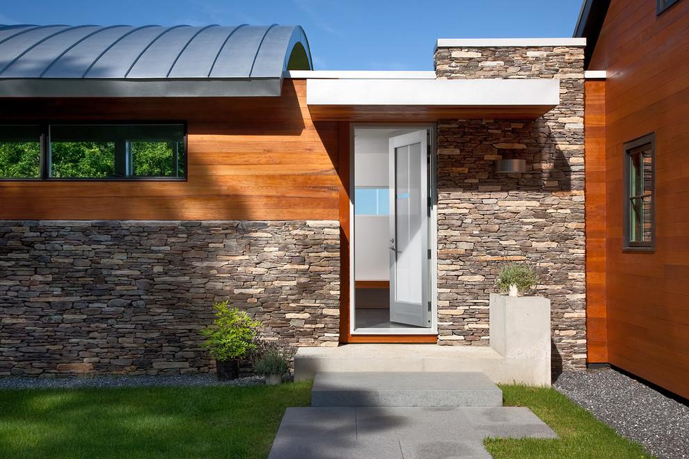 Inspiration for a mid-sized contemporary granite floor single front door remodel in Bridgeport with a glass front door