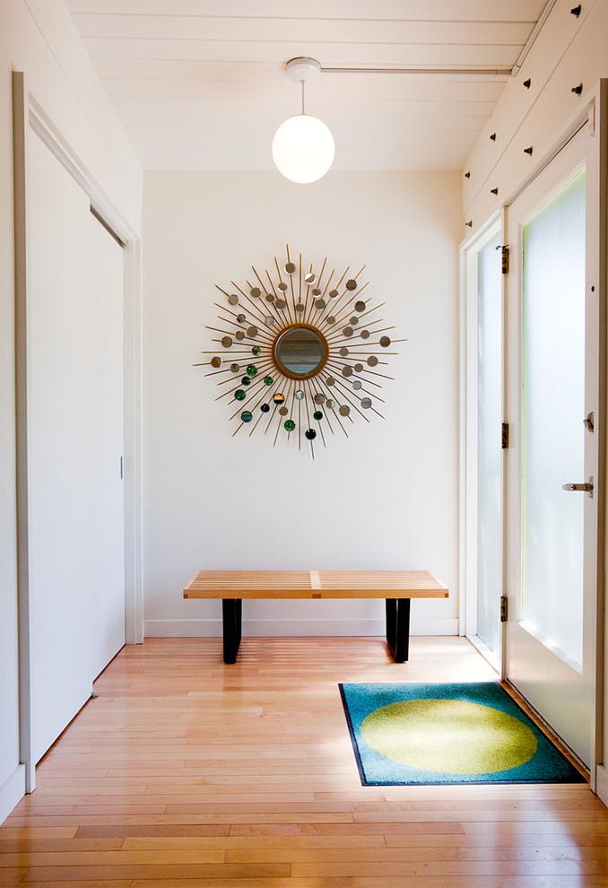 Single front door - mid-century modern single front door idea in Seattle with a glass front door