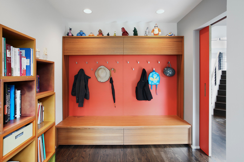 Mudroom - mid-sized contemporary dark wood floor and brown floor mudroom idea in Seattle with red walls