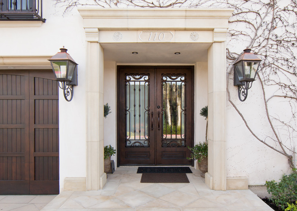 Inspiration for a mediterranean entryway remodel in Orange County with a dark wood front door