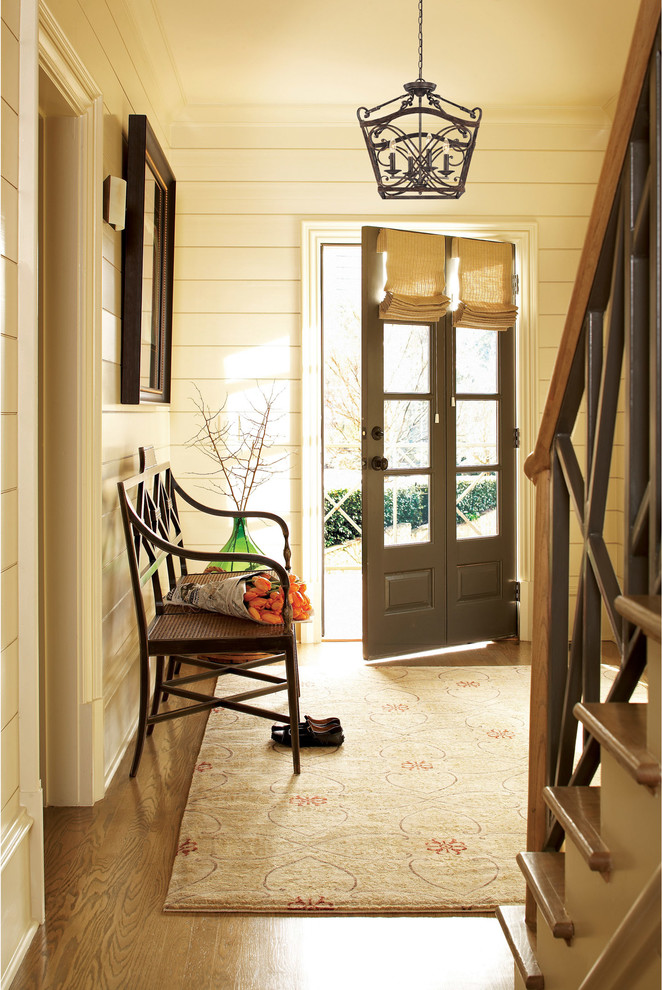 Inspiration for a farmhouse entryway remodel in Austin with beige walls and a gray front door