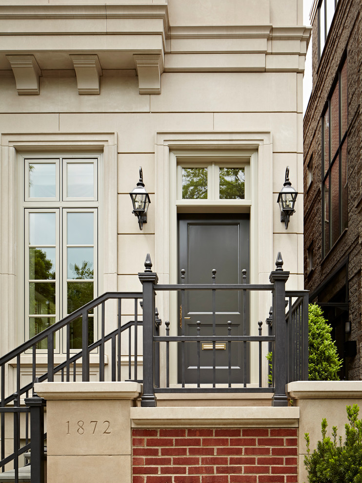 Example of a huge classic entryway design in Chicago with a gray front door