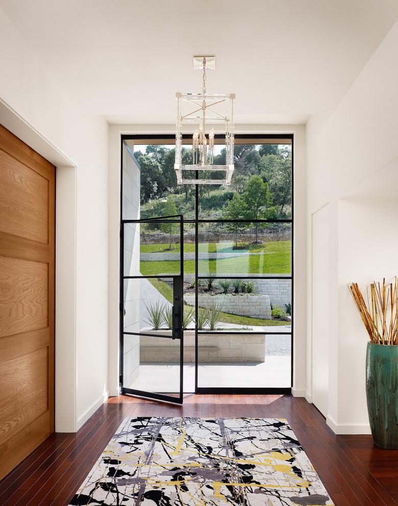 Entryway - contemporary entryway idea in Austin with a glass front door