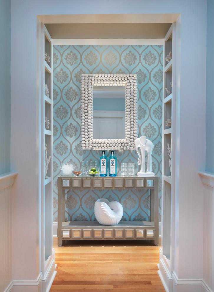 Entry hall - coastal medium tone wood floor entry hall idea in Providence with blue walls