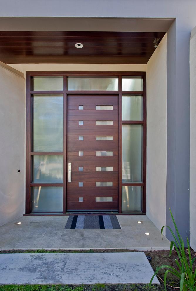 Entryway - contemporary entryway idea in San Francisco with a dark wood front door