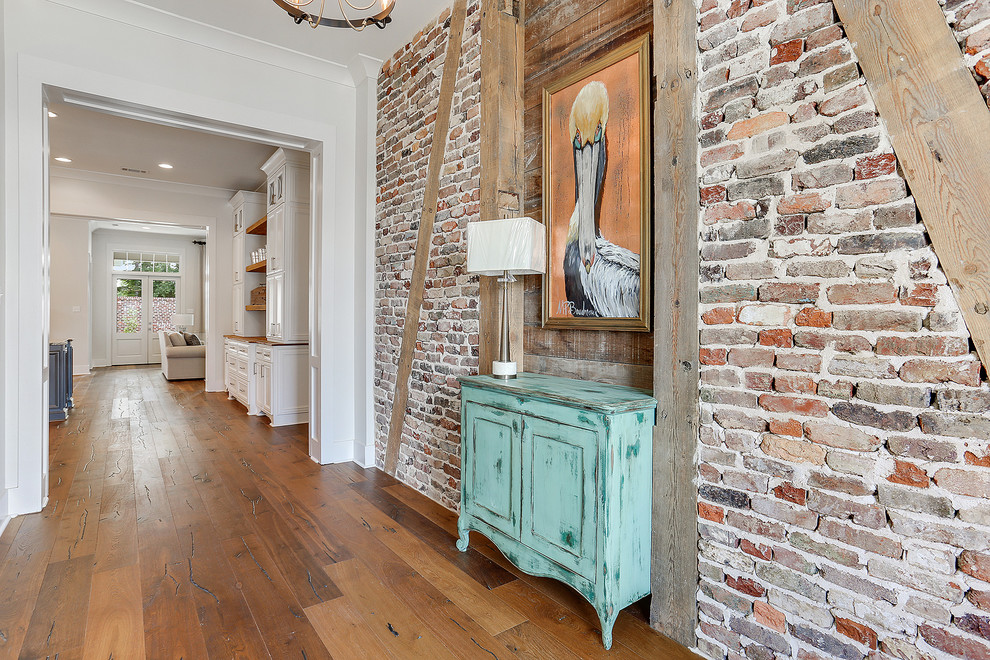 Entryway - mid-sized country dark wood floor and brown floor entryway idea in New Orleans with red walls