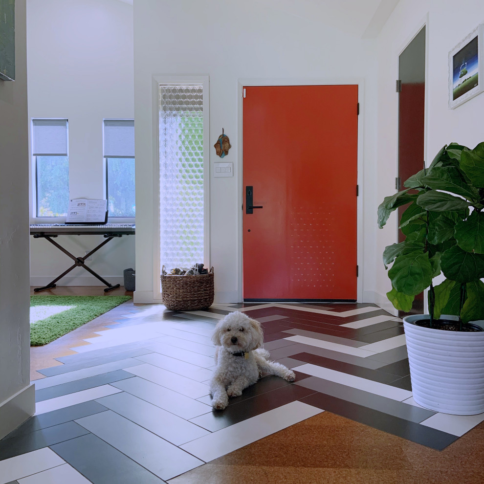Mid-sized mid-century modern porcelain tile, multicolored floor and vaulted ceiling entryway photo in San Diego with white walls and an orange front door