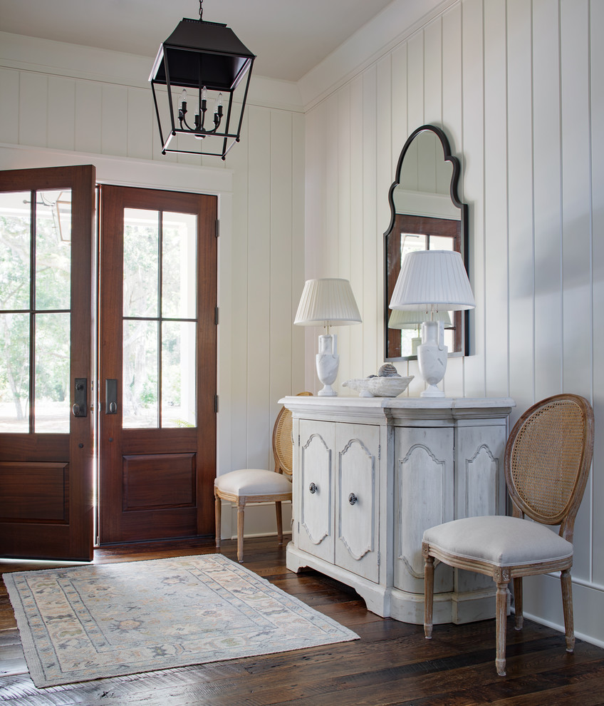 Inspiration for a coastal dark wood floor and brown floor entryway remodel in Atlanta with white walls and a dark wood front door