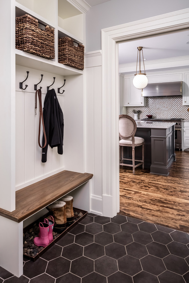 Example of a classic mudroom design in Minneapolis with white walls