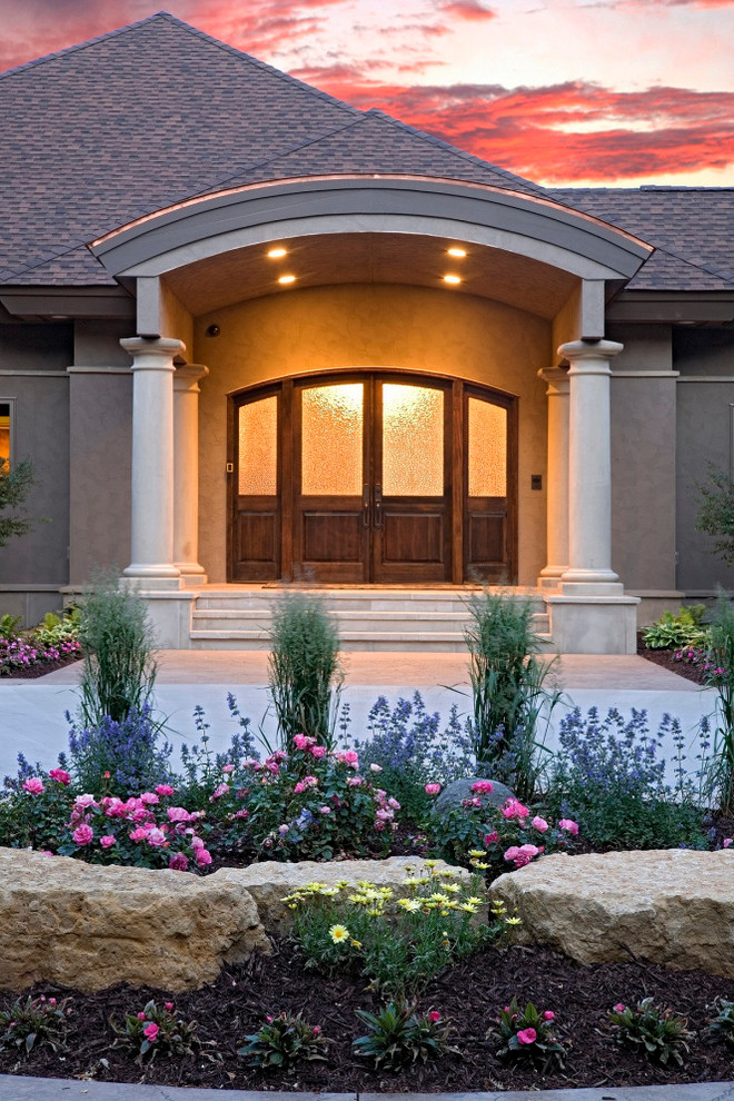 Double front door - traditional double front door idea in Minneapolis with a dark wood front door