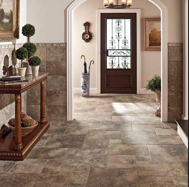 Mid-sized trendy travertine floor and gray floor entryway photo in Tampa with beige walls and a dark wood front door