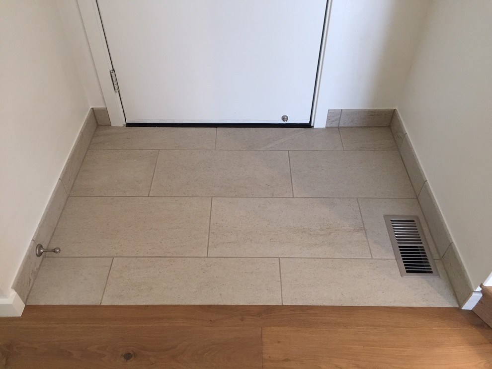Small transitional porcelain tile and beige floor entryway photo in Portland with white walls and a white front door