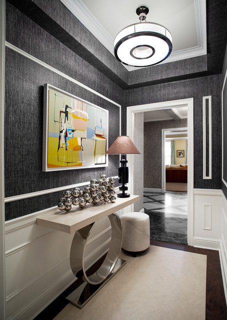Transitional dark wood floor entry hall photo in New York with gray walls
