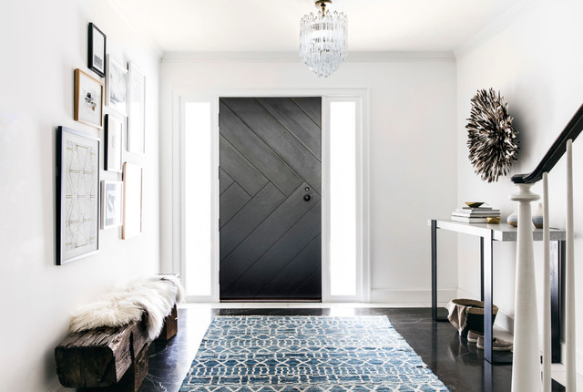 Entryway - transitional dark wood floor and brown floor entryway idea in San Francisco with white walls and a black front door