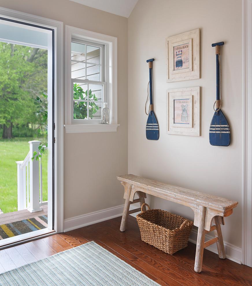 Single front door - mid-sized beach style medium tone wood floor single front door idea in Boston with beige walls
