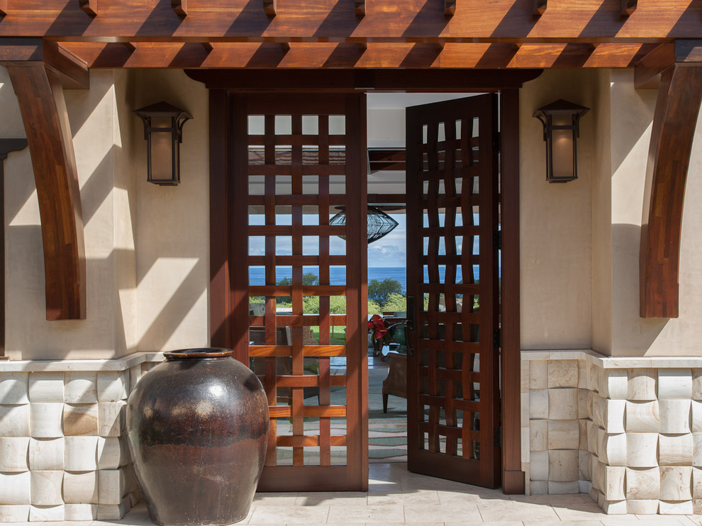 Double front door - mid-sized tropical double front door idea in Hawaii with a dark wood front door