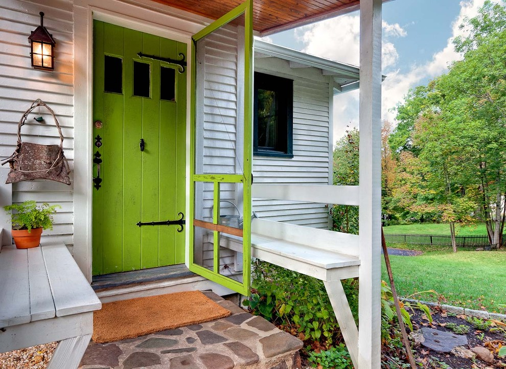 Inspiration for a timeless entryway remodel in Other with a green front door