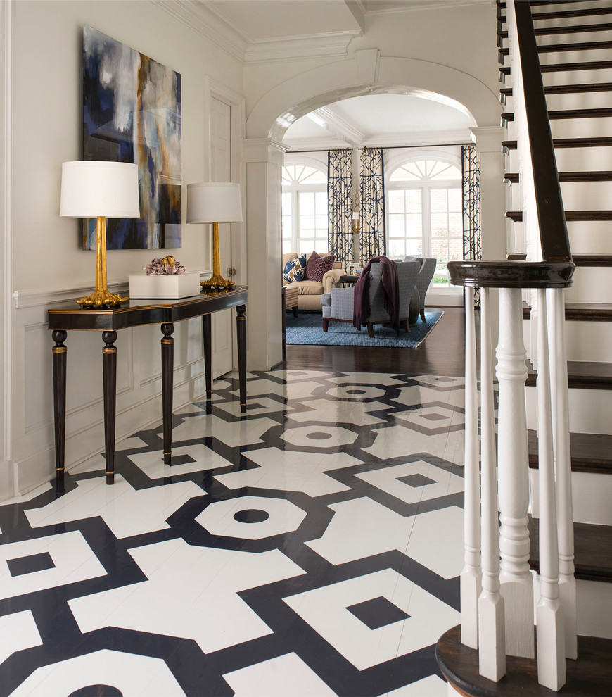 Example of a classic multicolored floor entryway design in Dallas with white walls