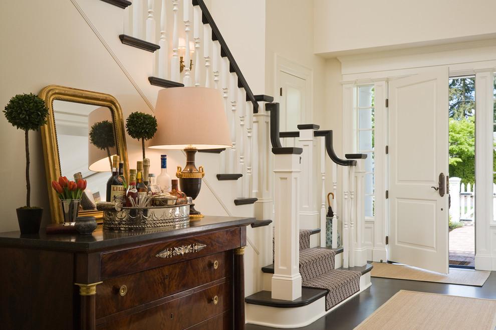 Foyer - traditional black floor foyer idea in Seattle