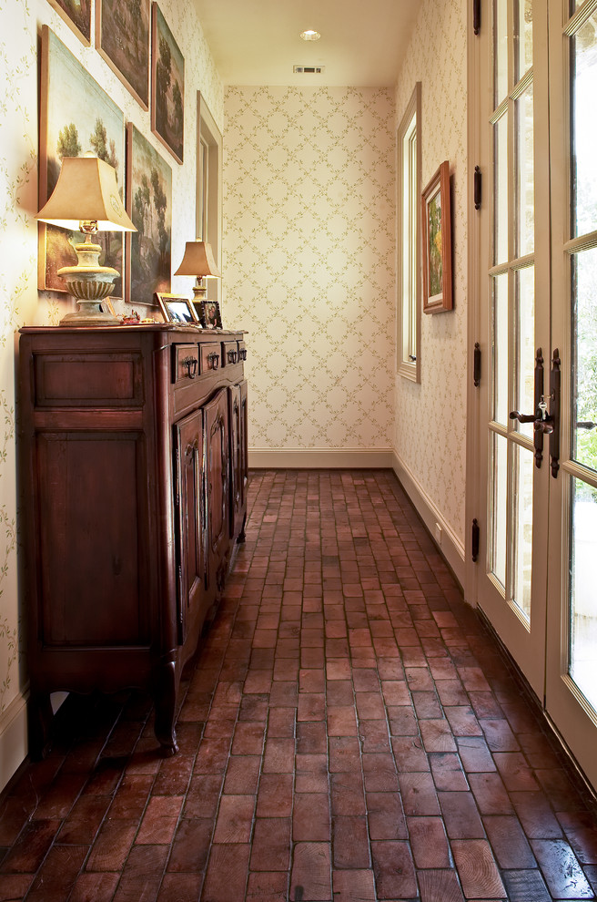 Tuscan brick floor entryway photo in Houston