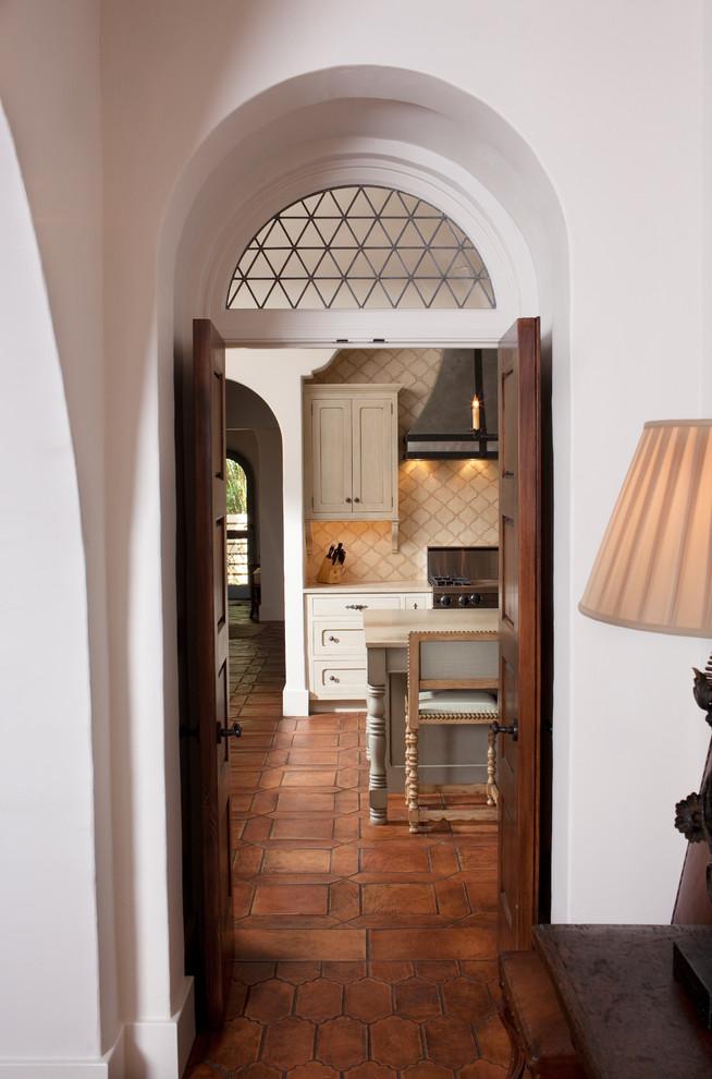 Double front door - mediterranean terra-cotta floor double front door idea in Other with a dark wood front door