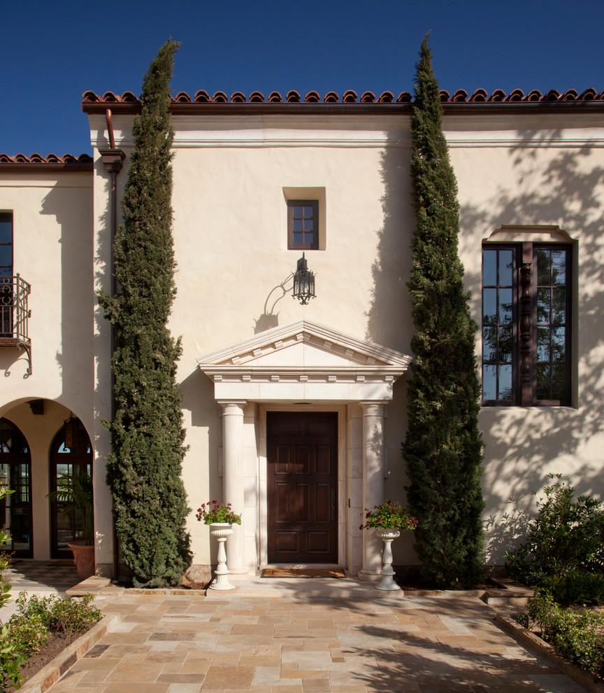 Entryway - mediterranean entryway idea in Santa Barbara with a dark wood front door