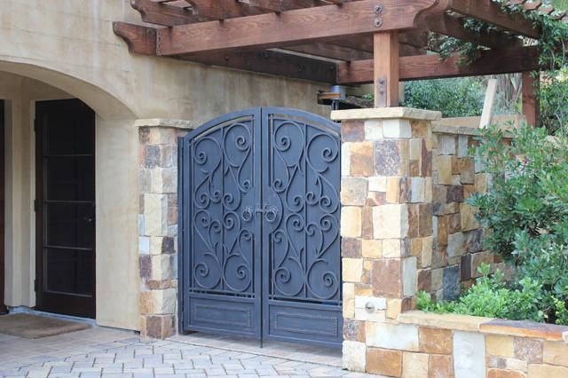 Mediterranean style ornamental iron enclosure gates