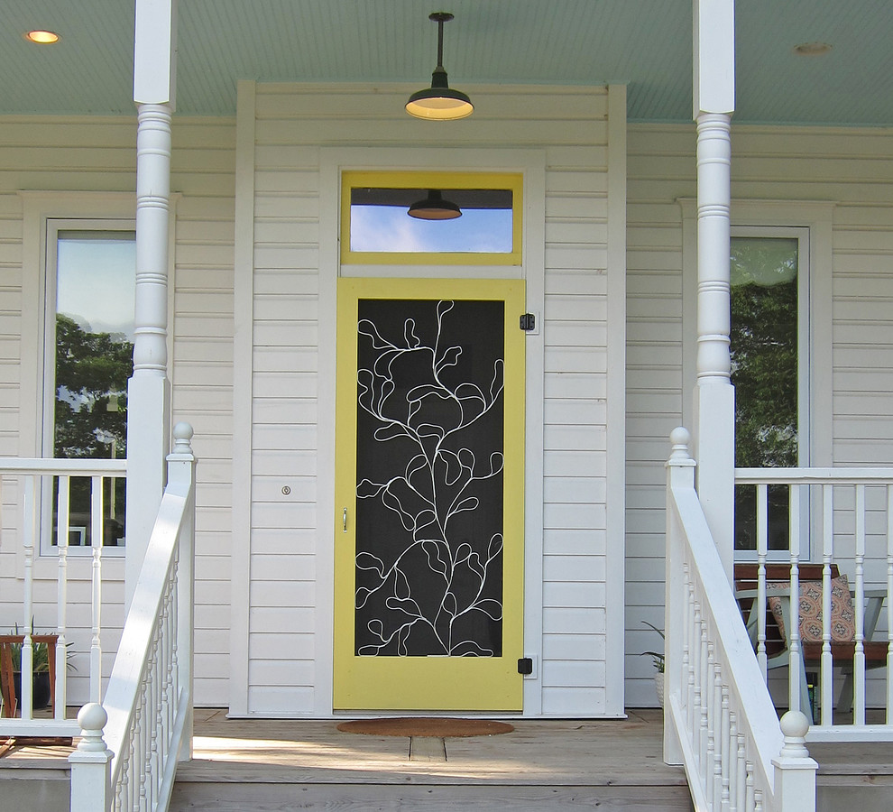 Example of a classic entryway design in Austin with a yellow front door
