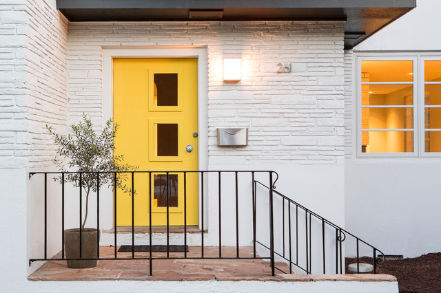 Entryway - 1960s slate floor entryway idea in Charleston with white walls and a yellow front door
