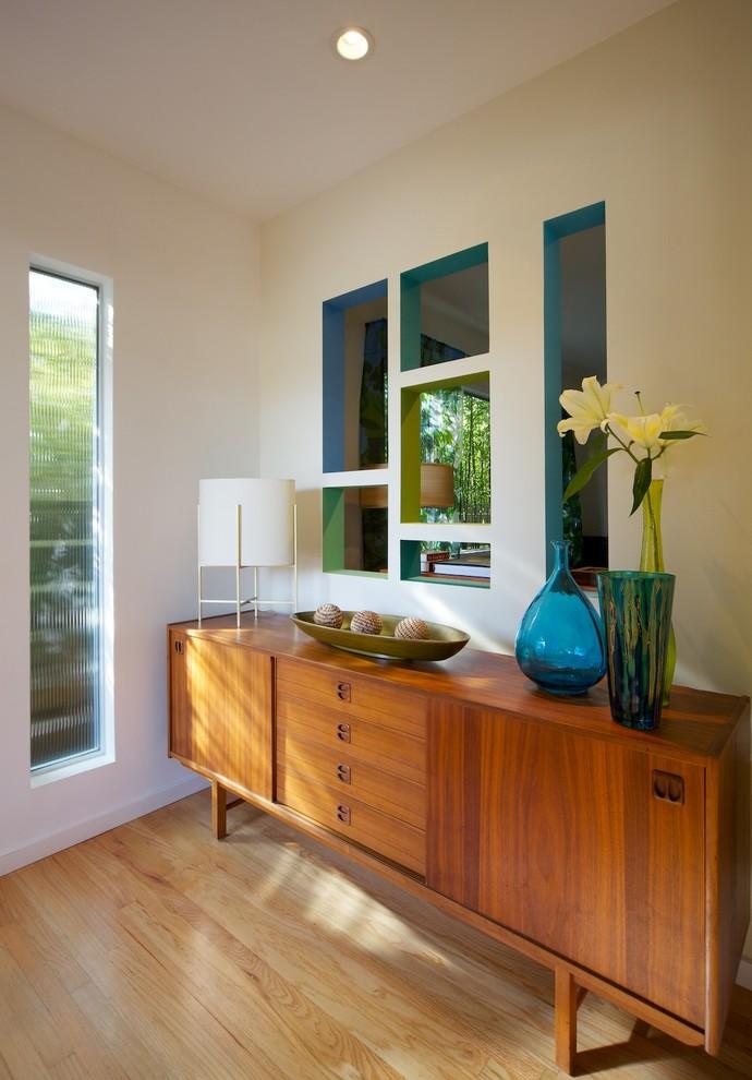 Entryway - 1960s light wood floor entryway idea in Los Angeles with beige walls