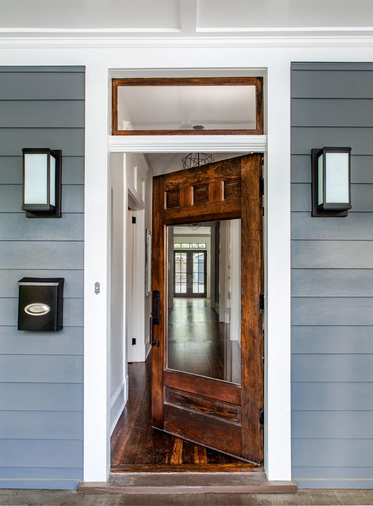 Example of a classic entryway design in Atlanta with a medium wood front door