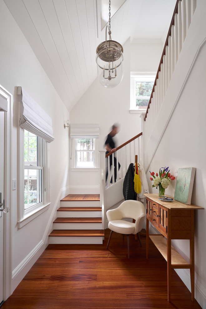Example of a mid-sized arts and crafts medium tone wood floor and brown floor entryway design in San Francisco with white walls