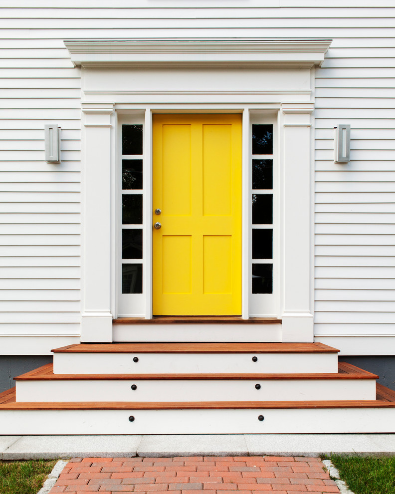Entryway - transitional entryway idea in Boston with a yellow front door