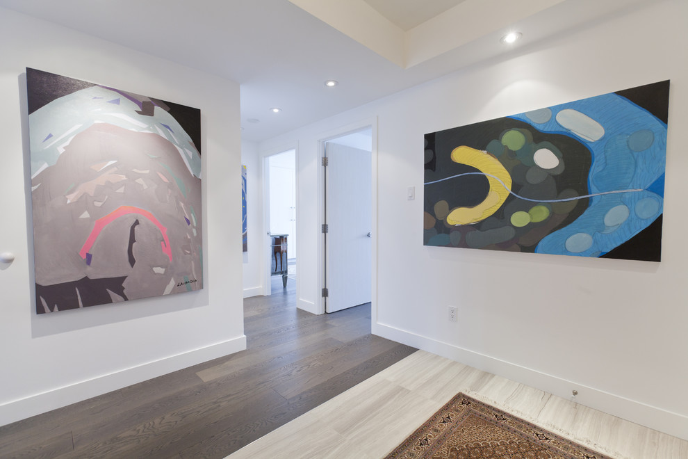 Example of a minimalist entryway design in Toronto with white walls