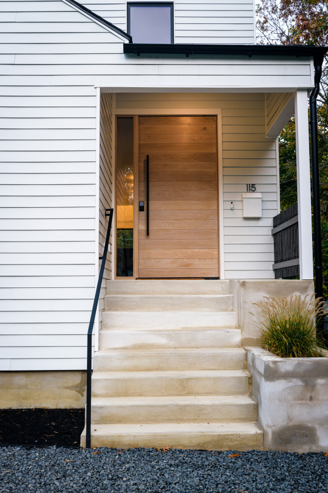 Inspiration for a large scandinavian entryway remodel in Philadelphia with white walls and a light wood front door
