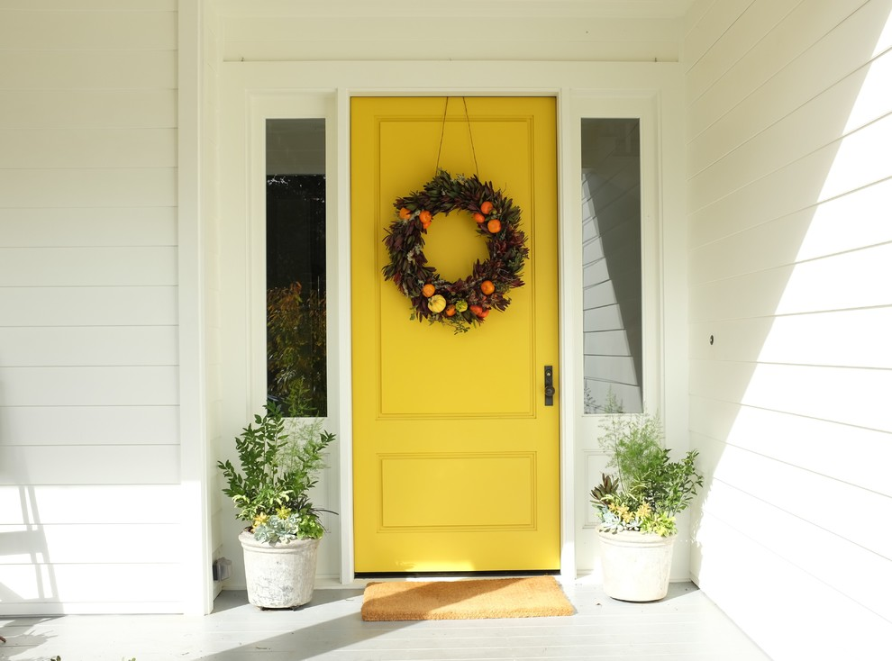 Entryway - contemporary entryway idea in San Francisco with white walls and a yellow front door