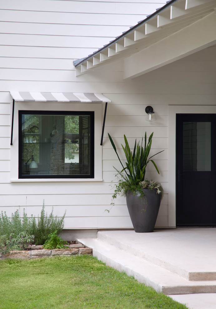 Farmhouse single front door photo in Austin with a black front door