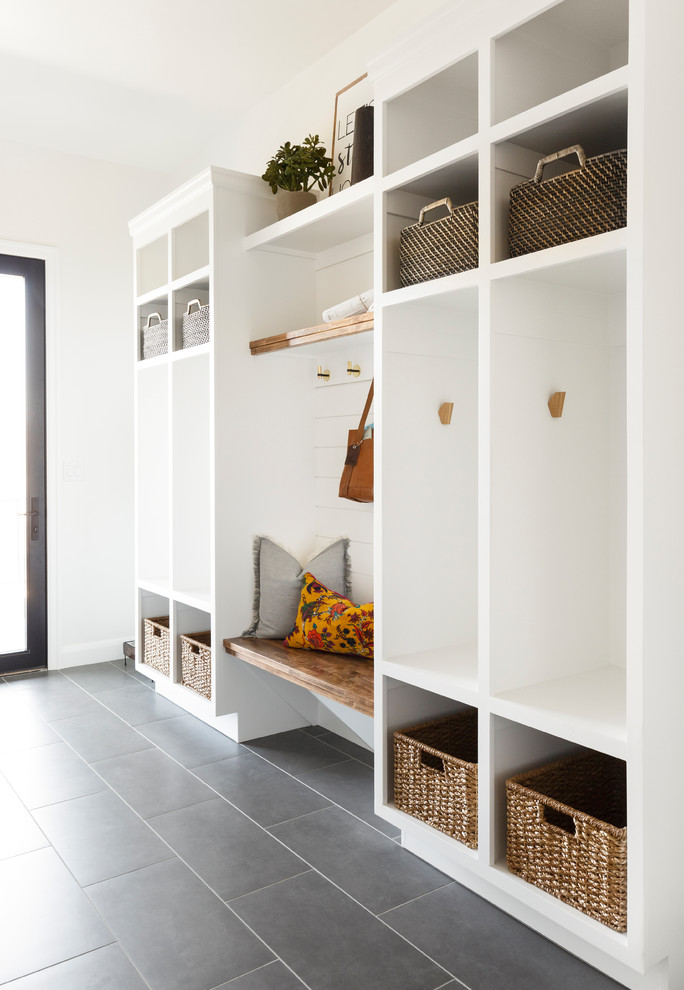 Inspiration for a mid-sized transitional ceramic tile and gray floor mudroom remodel in Salt Lake City with white walls