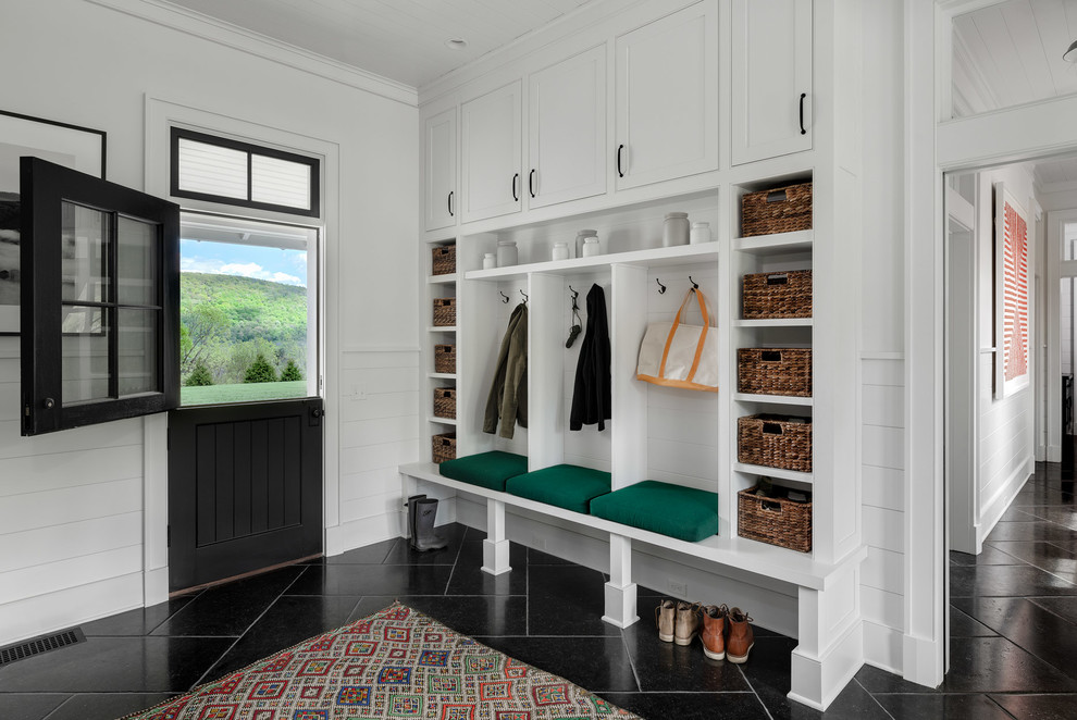 Inspiration for a large country black floor entryway remodel in New York with white walls and a black front door
