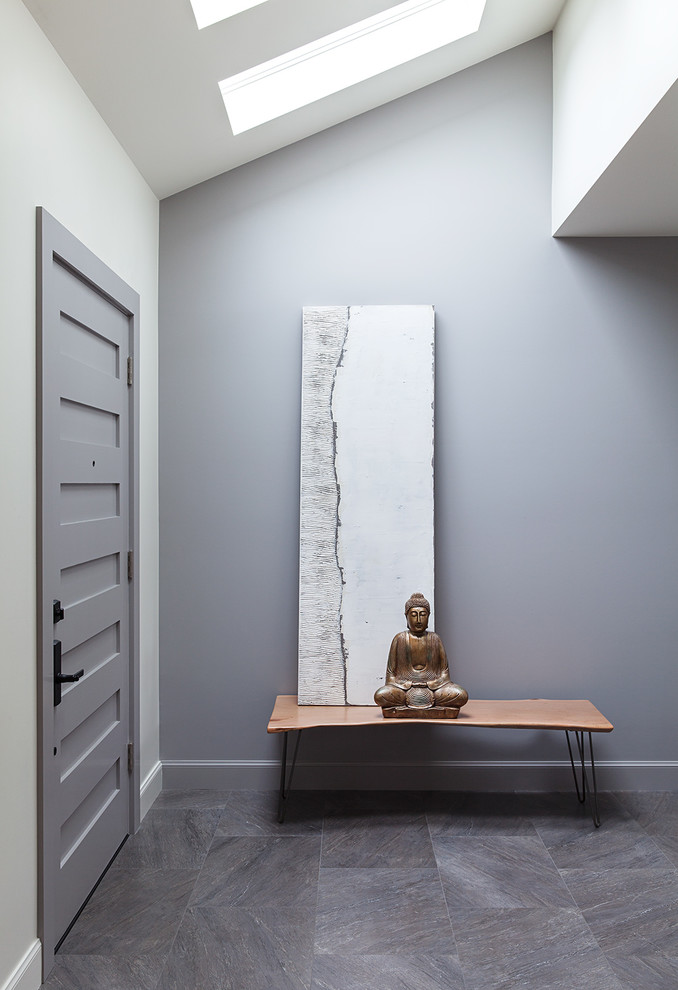 Entryway - huge modern porcelain tile entryway idea in San Francisco with gray walls and a gray front door