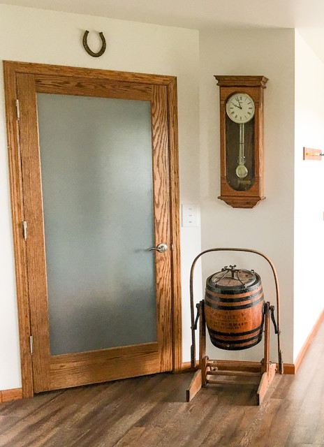 Example of a cottage entryway design in Other