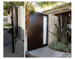 Modern Pivot Gate With a Flare of Mid Century Architectural Characteristics modern-garage-and-shed