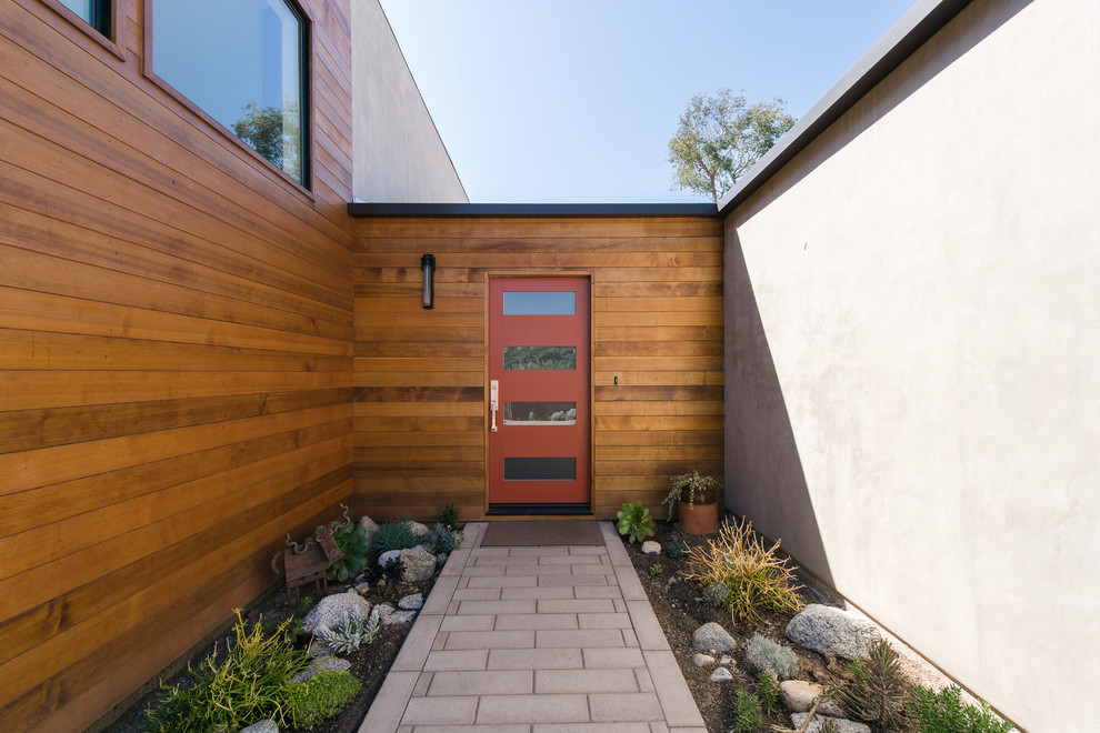 Medium sized contemporary front door in Los Angeles with grey walls, a single front door and a red front door.