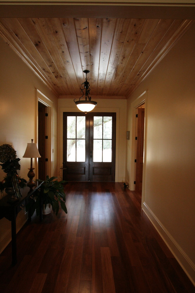 Inspiration for a craftsman medium tone wood floor entryway remodel in Miami with beige walls and a dark wood front door