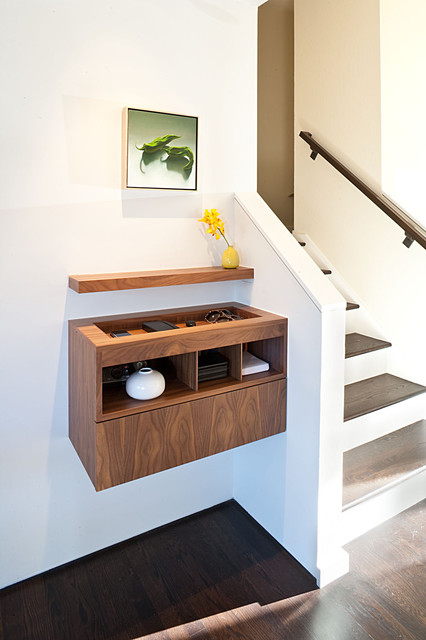 Inspiration for a 1950s dark wood floor entryway remodel in San Francisco with white walls