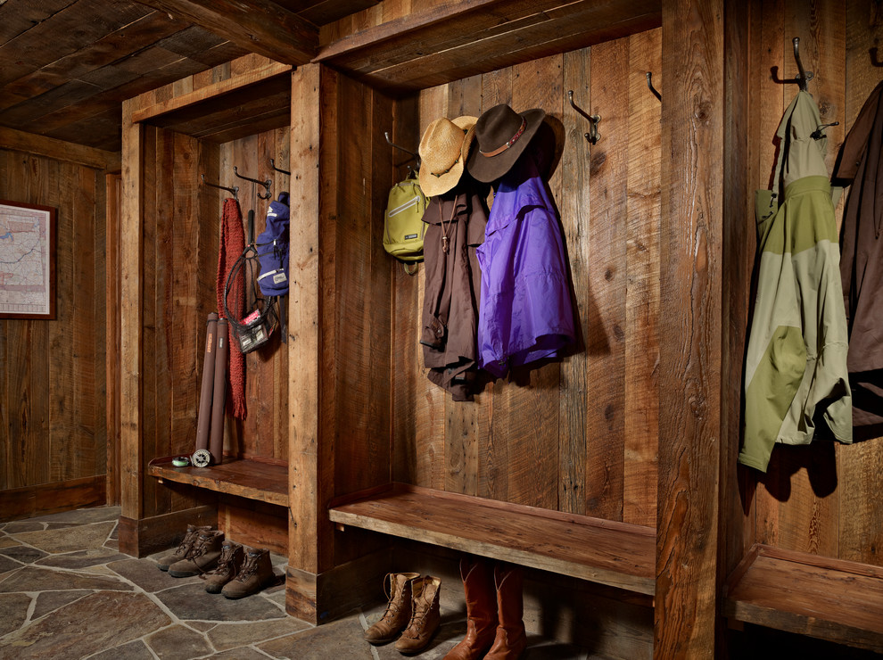 Inspiration for a large rustic slate floor mudroom remodel in Other