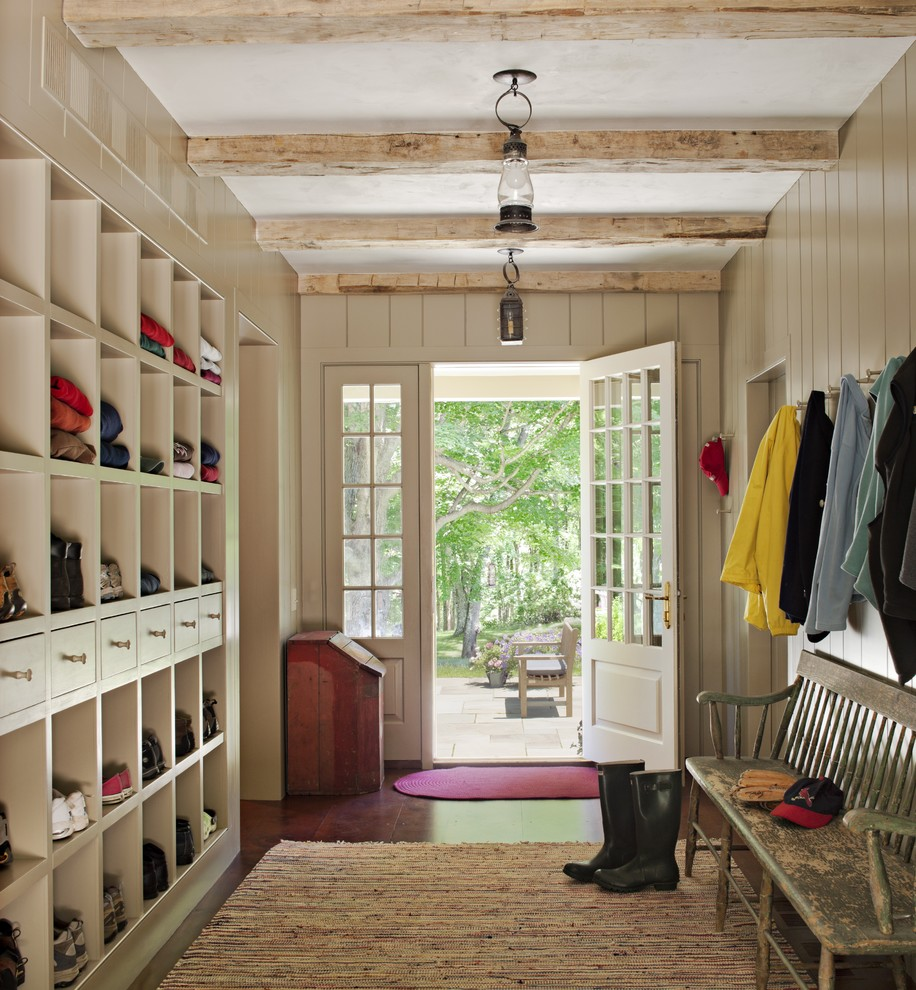 Example of a large cottage medium tone wood floor entryway design in New York with gray walls and a white front door