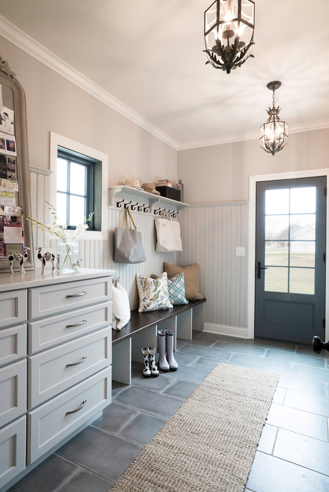 Mid-sized country porcelain tile and gray floor entryway photo in St Louis with beige walls and a gray front door