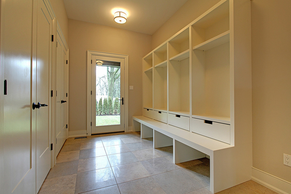 Example of a mid-sized classic porcelain tile entryway design in Toronto with beige walls and a white front door